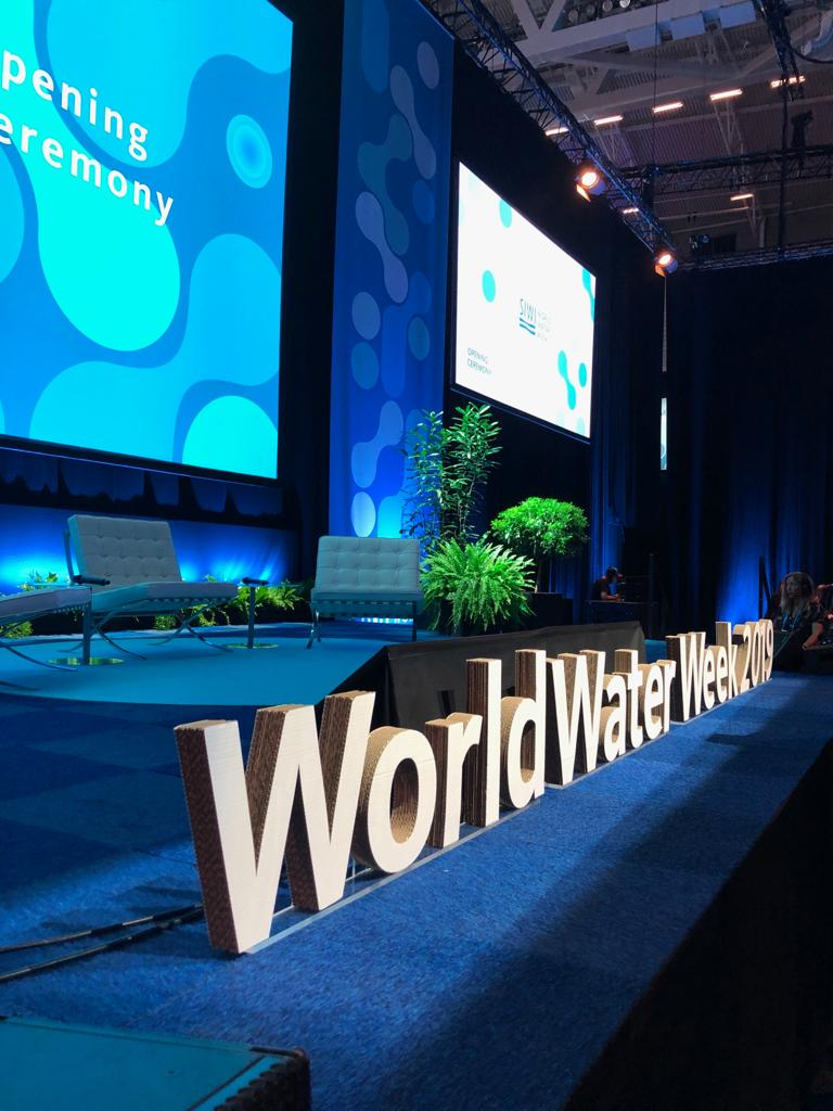 World Water Week sign on a stage.